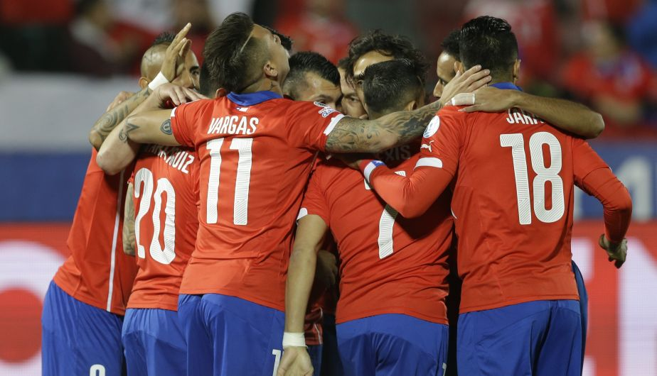 Chile's Charles Aranguiz, right, 20, celebrates with teammates after scoring against Bolivia during a Copa America Group A soccer match at El Nacional stadium in Santiago, Chile, Friday, June 19, 2015. (AP Photo/Jorge Saenz)